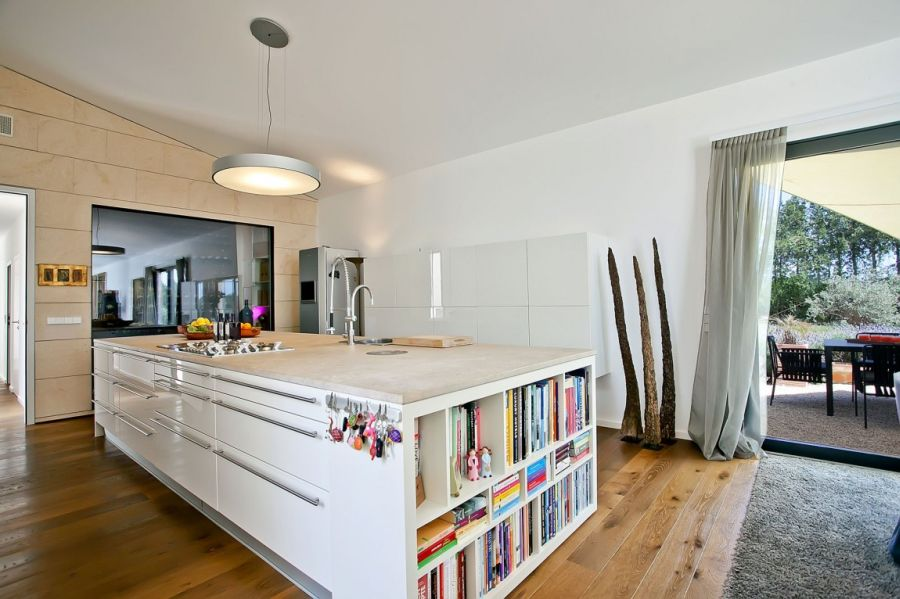 Kitchen island with bookshelf at its end