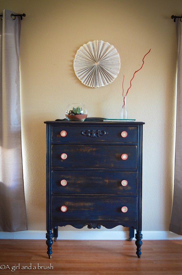 Navy blue dresser with red handles