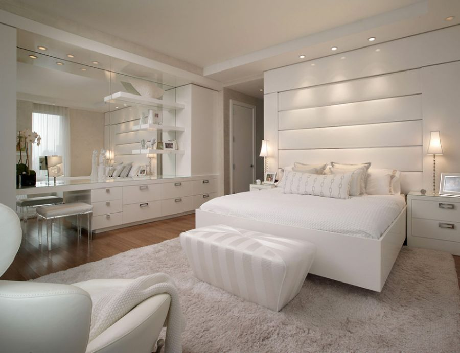 Plush white bedroom in the New York City home