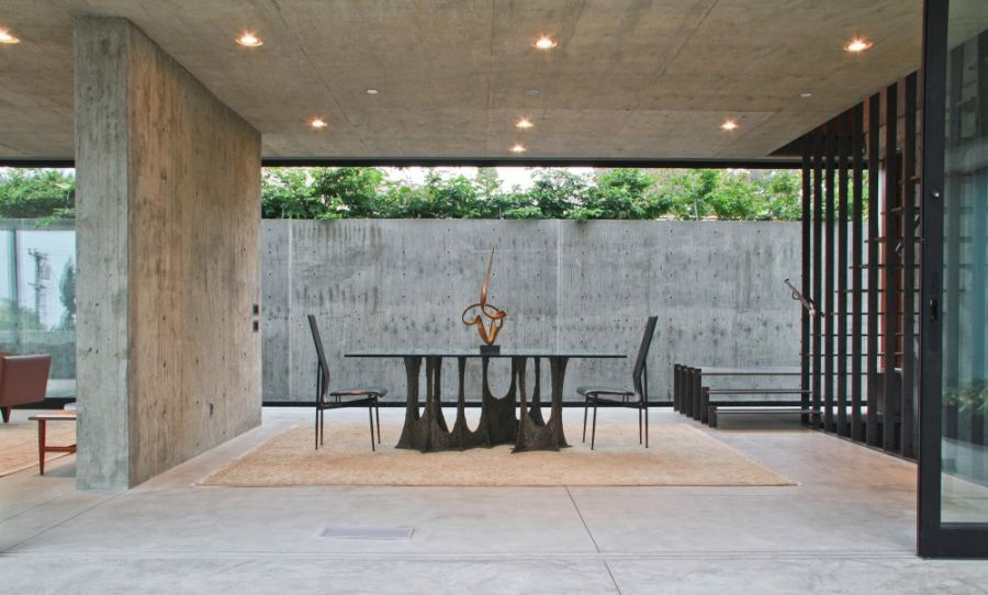 Exposed concrete walls and dining area