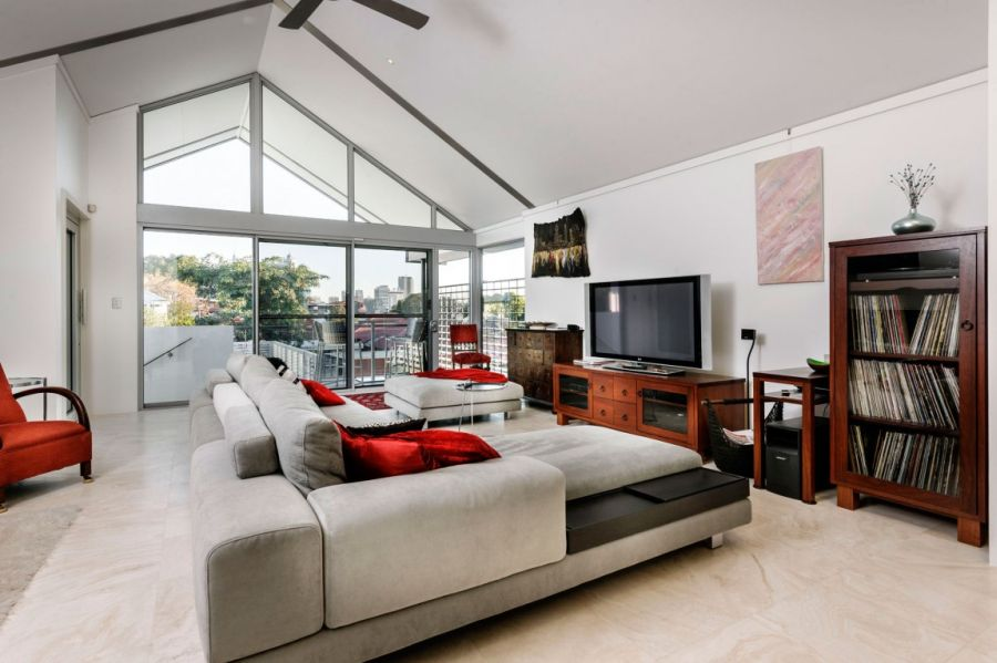 Red accents splurged around the living room