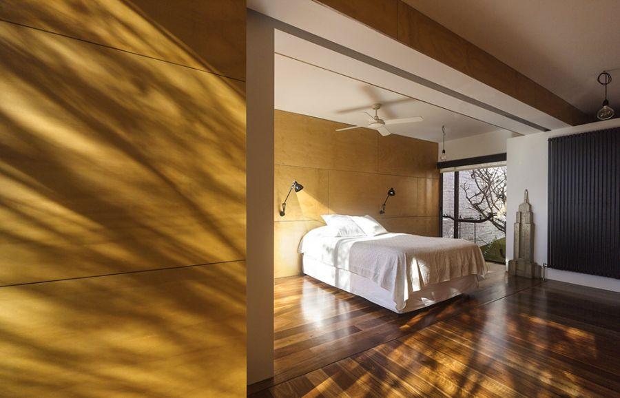 Elegant bedroomw with wooden flooring