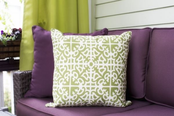 Purple and lime green color scheme on a front porch