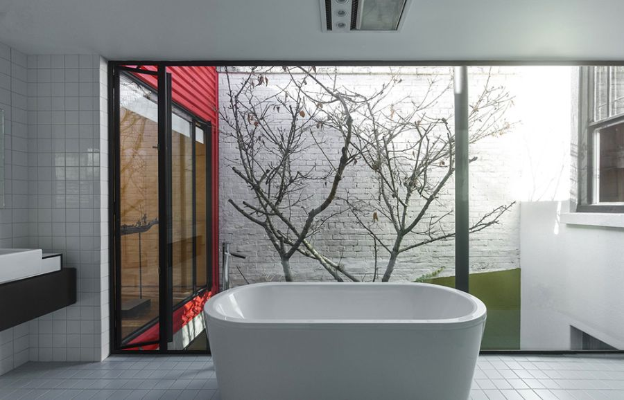 Stylish modern white bathroom with a view