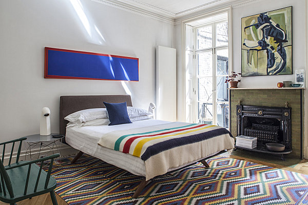 Stylish rug and throw in a cozy bedroom