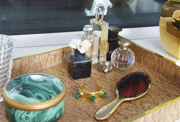 Accessories in a Hollywood Regency bathroom