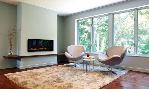 Comfy Swan chairs next to the sleek fireplace