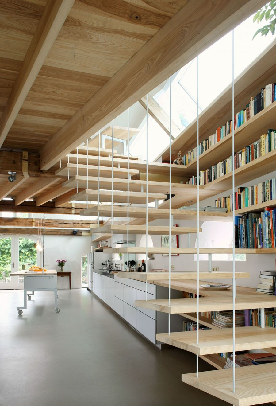 Floating wooden staircase in the dutch house