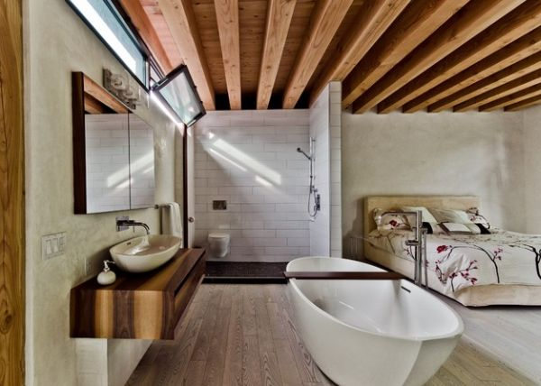 Open bathroom and bedroom design ideal for a compact bachelor pad