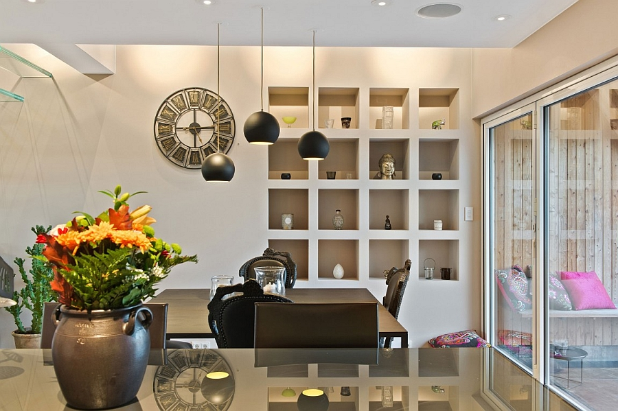 Black pendant lights above the dining table