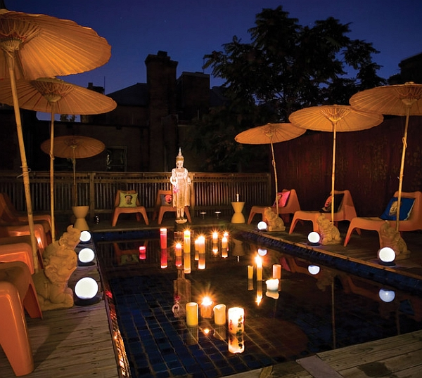 Brilliant lighting and candles create a tranquil reflecting pool with an oriental touch