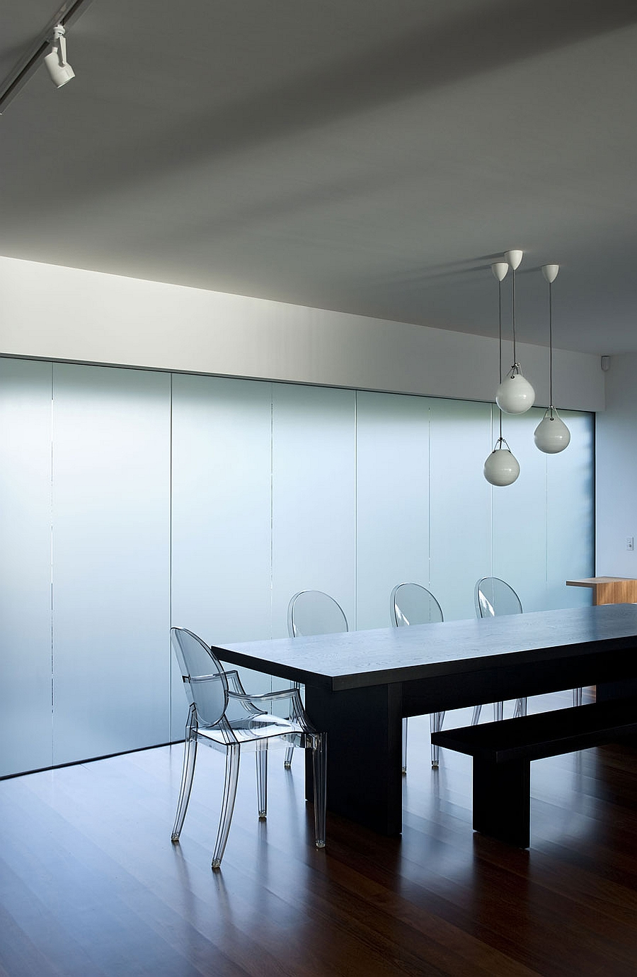 Contemporary dining room with ghost chairs