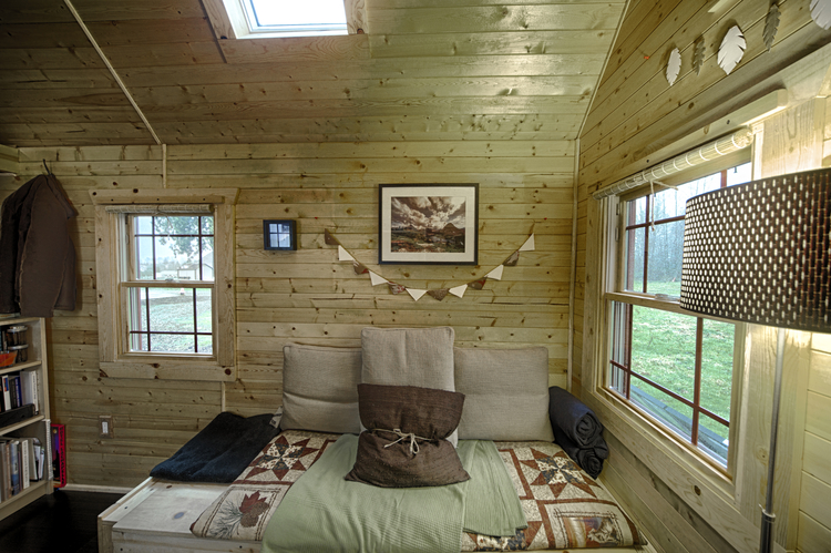 Interior of tiny home with wooden walls