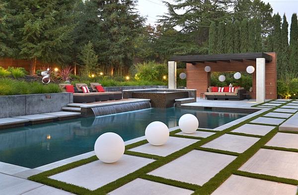 A perfect pool waterfall idea for those who love sleek minimalism