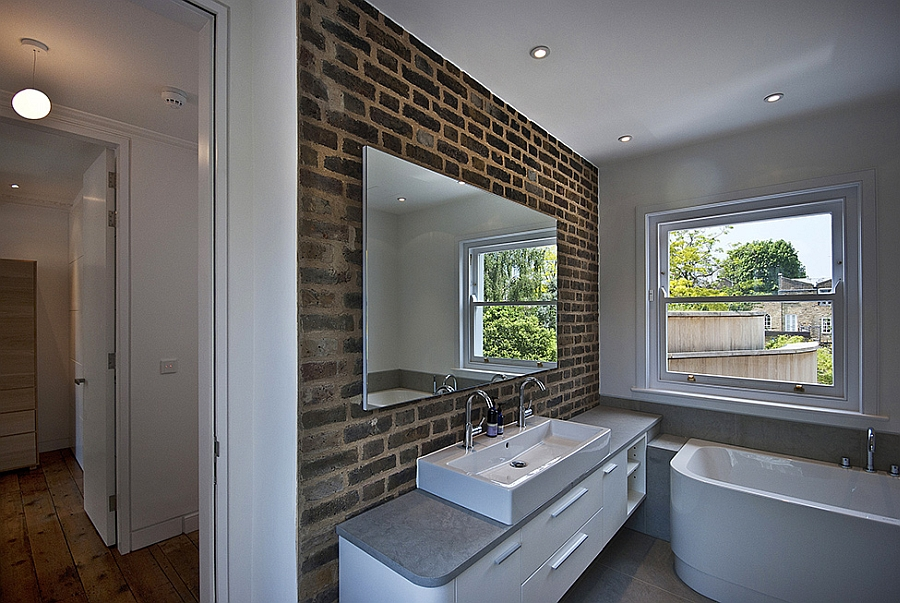 Cool exposed brik wall in the modern bathroom