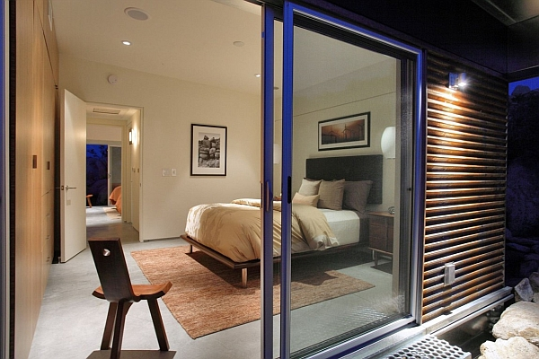Glass doors give the small bedroom a spacious look