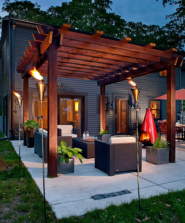Gorgeous torches create a truly spellbinding pergola setting