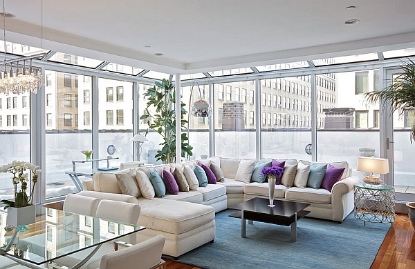 Rug and throw pillows add color instantly in the New York Penthouse