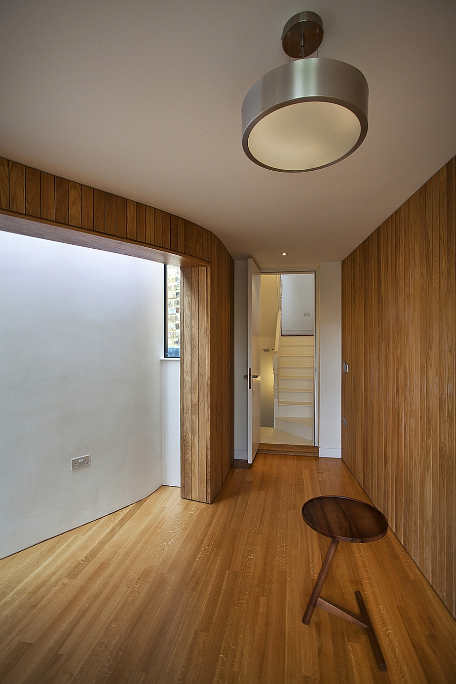 Timber clad surfaces add warmth to the London House