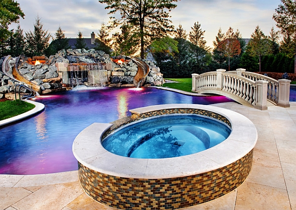 Twin slides on either side of the waterfall add a playful element to the pool design
