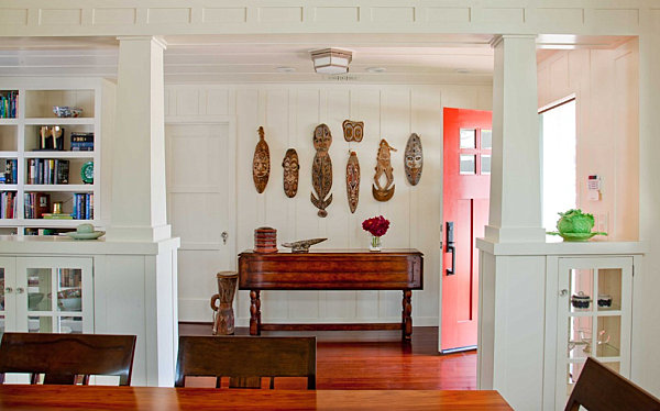 Cottage entryway with tribal masks