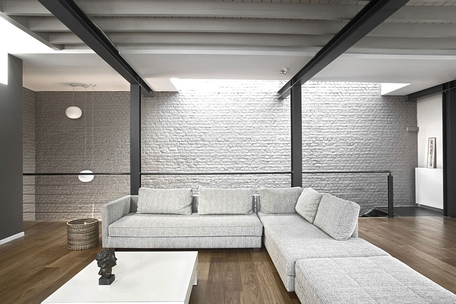 Exposed brick walls and steel frame in the living room