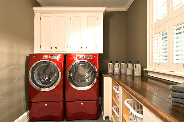Laundry room with cabinet and under-counter shelving