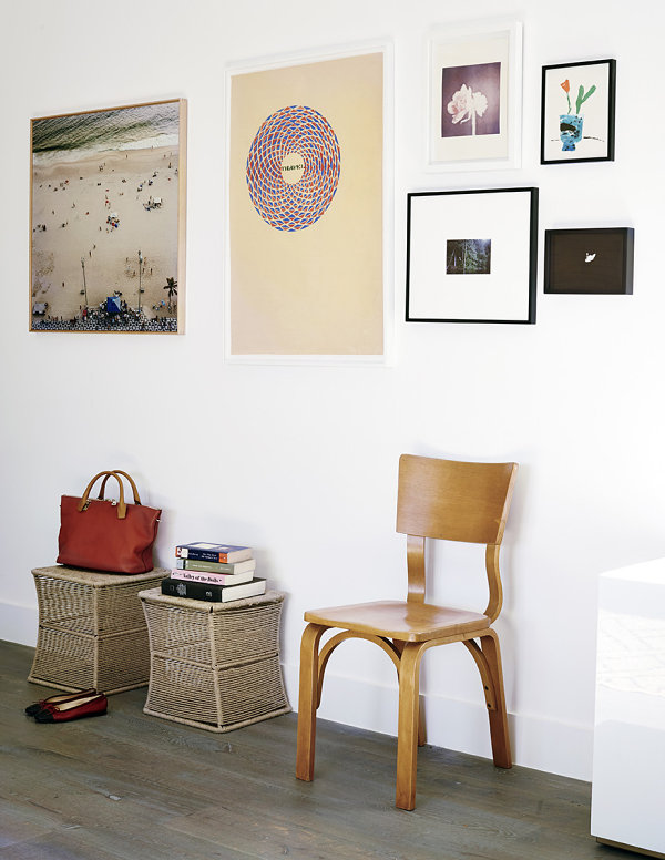 Seating and artwork in a modern entry