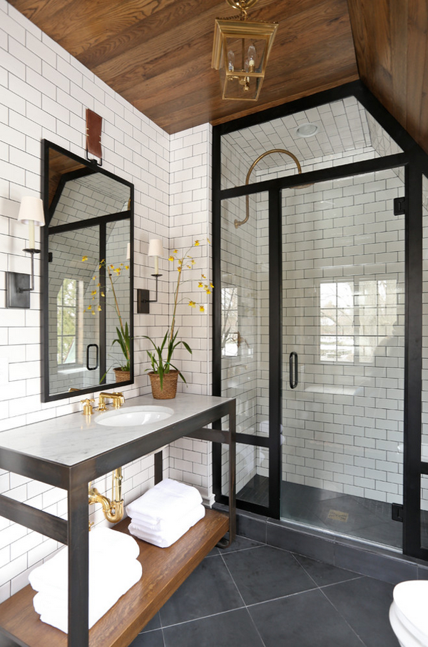 brass and subway tile bath