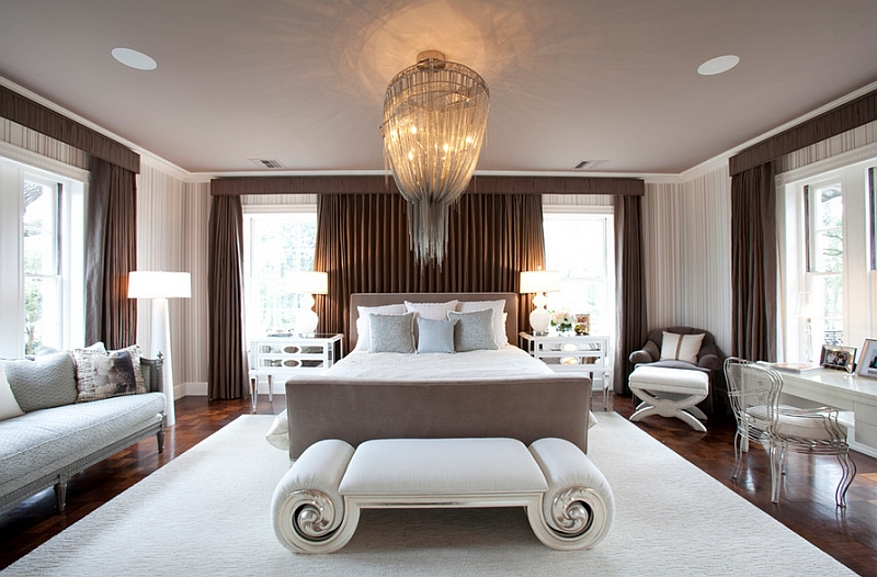 A combination of floor lamps and stunning chandelier in the bedroom