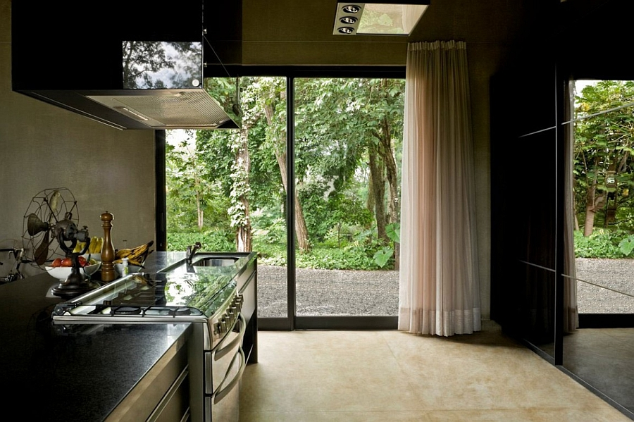 Exposed concrete lends the kitchen an industrial vibe