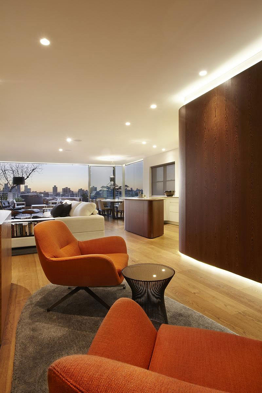 Lovely orange chairs add color to the sydney apartment