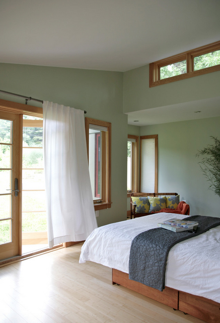 Peacefully designed bedroom with green walls