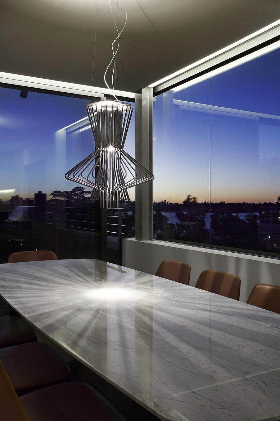 Snazzy pendant light above the dining table