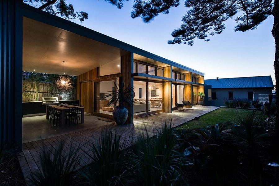 Warm lighting enlivens the house at dusk