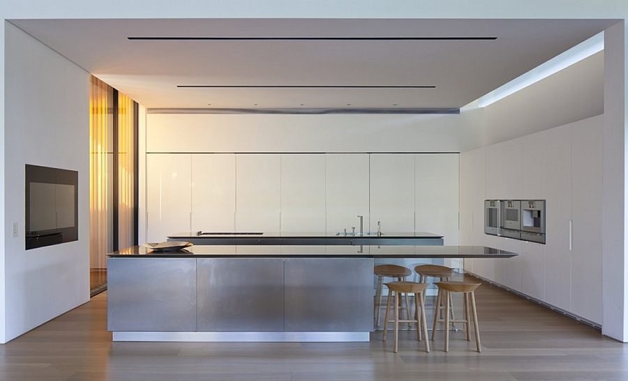Beautiful modern kitchen in white with an extended serving area