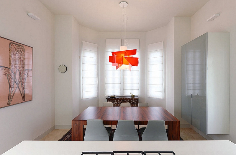 Big Bang Suspension lamp adds color to the fabulous dining room