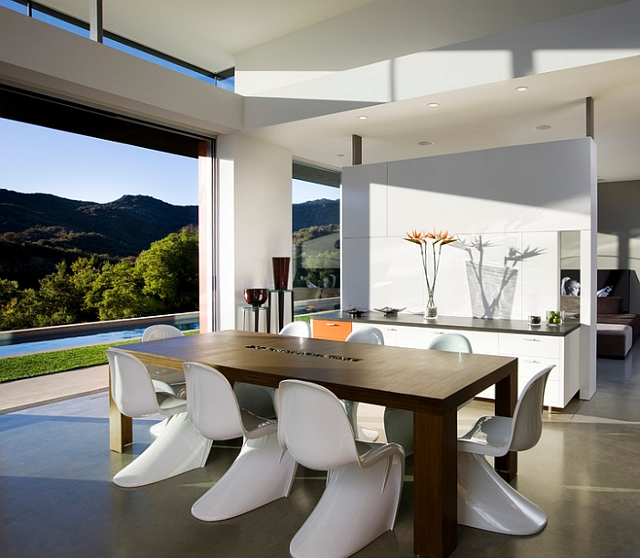 Classic Panton chairs and the view outside lend elegance to the dining room
