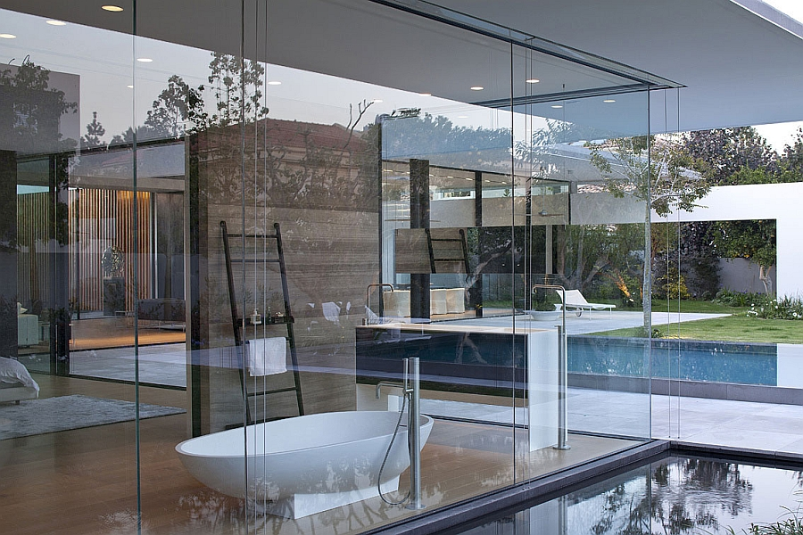 Glass walls surround the bathtub in the master bedroom