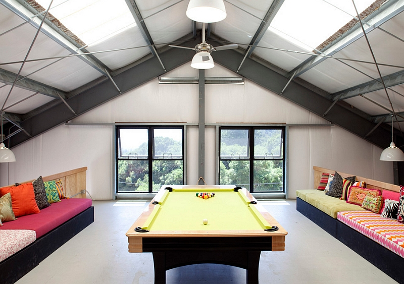 Restrained use of color in the stylish attic game room
