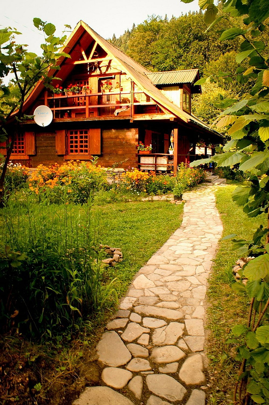 Stone pathway that leads to the lovely rustic Romanian House