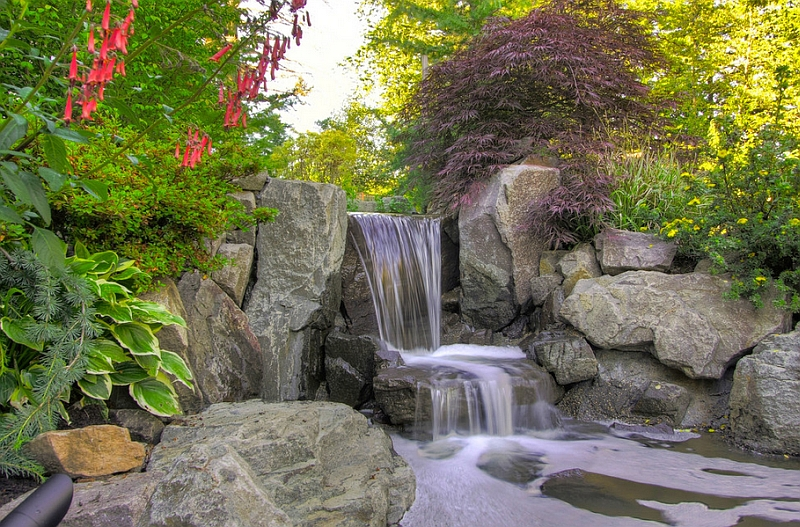 A natural water feature and a pond to create a stunning and soothing landscape