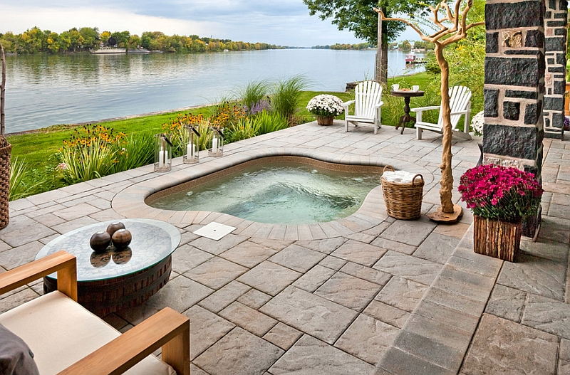 An outdoor space with hot tub that truly epitomizes the spirit of summer!