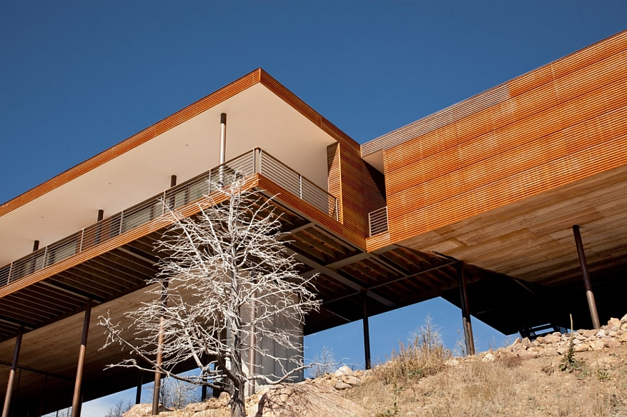Cantilevered Mountain home with a wooden exterior