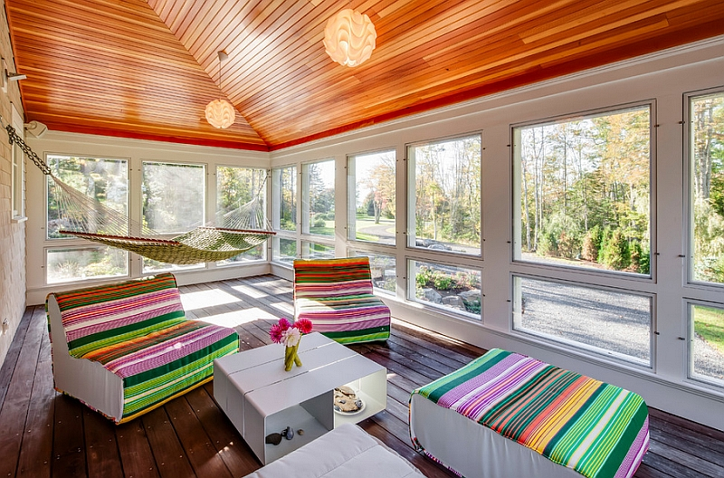 Colorful decor additions and the hammock add a hint of playfulness to the porch