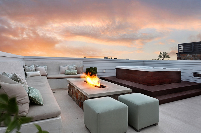 Create a comfortable lounge next to the outdoor hot tub