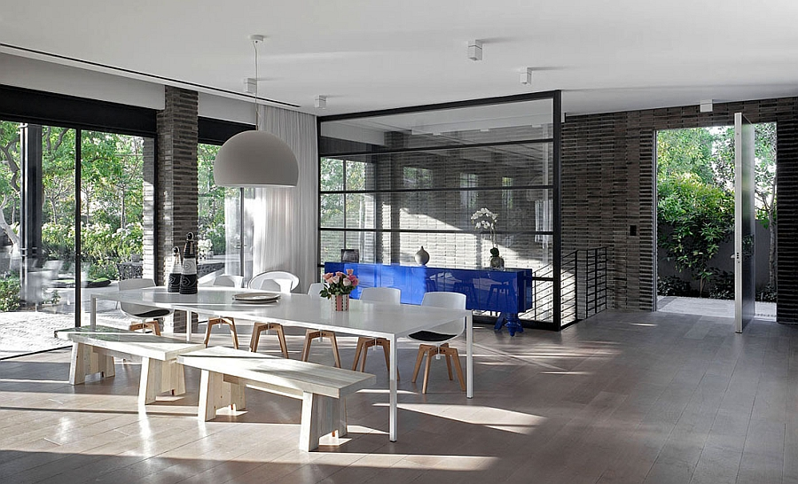 Glass and steel lend a touch of industrial charm to the space
