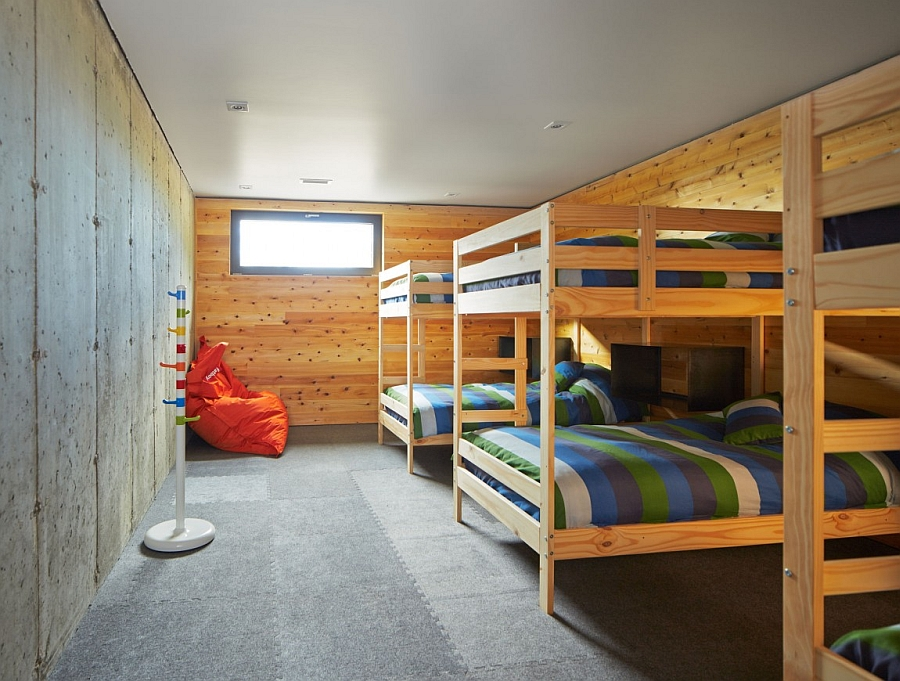 Kids' room with bink beds and a rustic cabin look