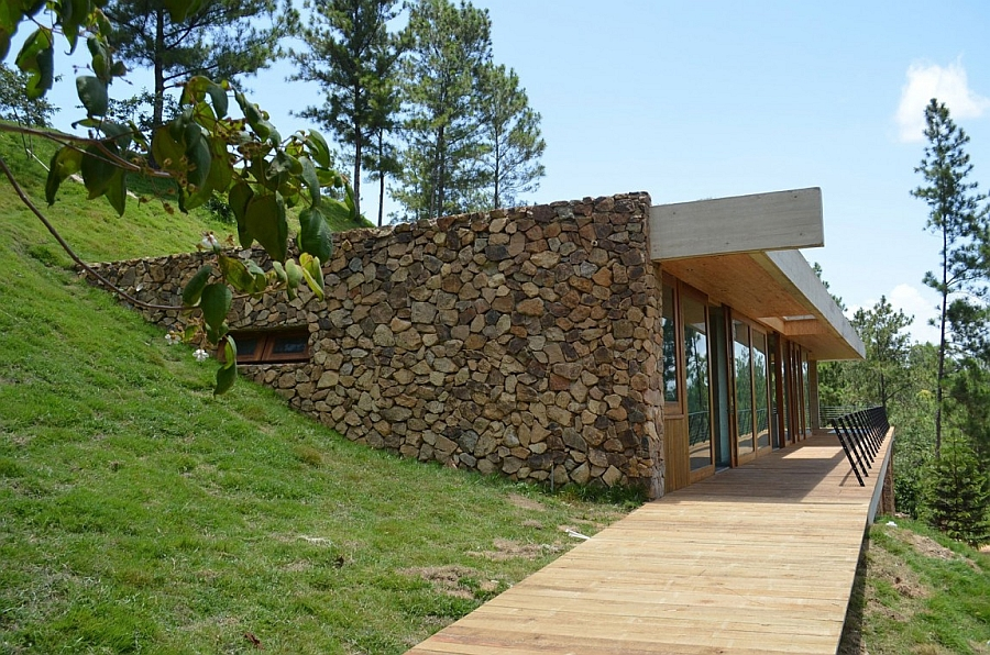 Natural materials like stone and wood shape the exterior