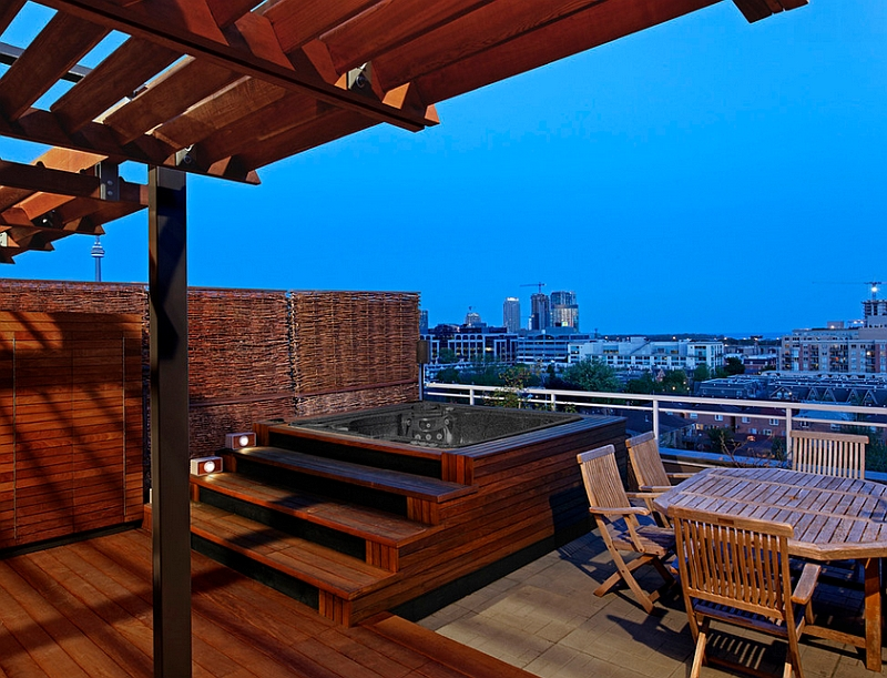 Rooftop patio with a hot tub and a wooden deck offers stunning views of Toronto skyline